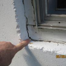 Caulking is needed to prevent water infiltration and damage and window trim needs to be scraped and painted.